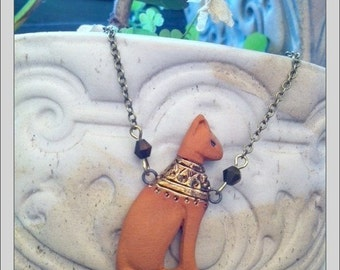 Egyptian Bastet necklace in terracotta brown, black or in  turquoise color - seated cat with gold collar - Collana Gatto