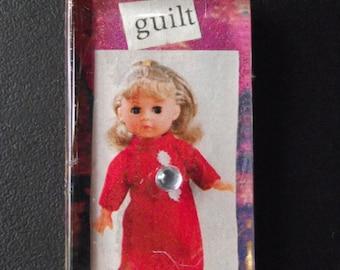 guilt magnet pendant