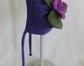 Child's purple fleece tie hat with fushia colored posie silly top