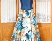 Womens formal top with spaghetti straps, rhinestone buttons, and satin trim