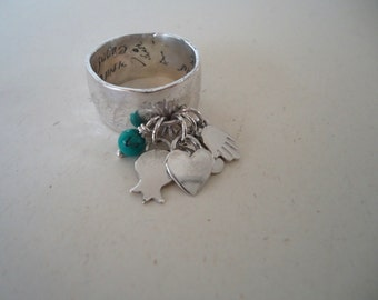 Sterling silver ring wide with silver charms.