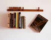 CUSTOM listing for Rebecca. Custom made wooden book rack / bookshelf in Walnut. Pins also work as bookmarks. Bookcase