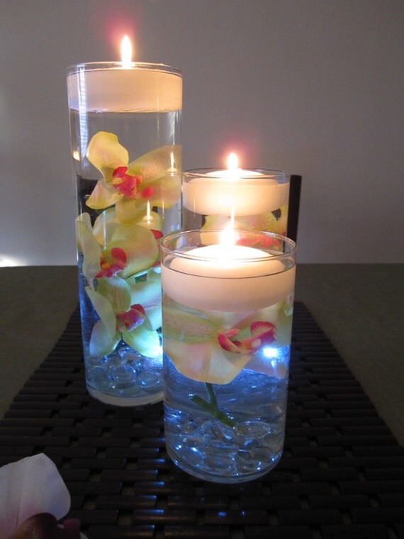 Green pink orchid floating candle wedding centerpiece