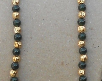 Adjustable Gold and green glass bead necklace