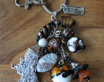 Beaded keychain, purse charm, made with White, Black and Marron Beads.
