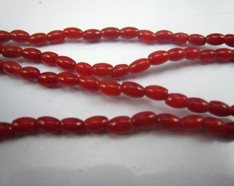 red coral rice bead 8x4mm 15 inch strand