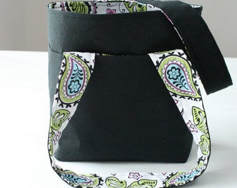 black purse with bright paisley lining