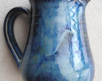 Small blue ceramic vase. Stoneware. perfect condition