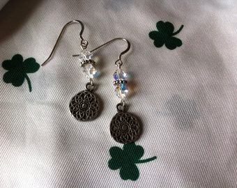 Clear crystal and silver pierced earrings with celtic knot flower charms