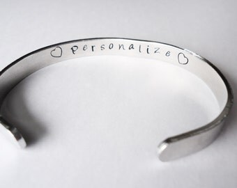 Custom Hand stamped cuff- You choose the words and or the designs stamped on it - made just for you - custom bracelet