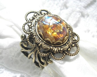 Gold Dust Ring - Topaz Harlequin Art Glass Opal in Antiqued Brass