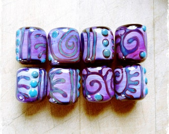 "Lampwork glass bead set handmade by Lori Lochner ""Tribal elements purple batik set"" (5 beads)"