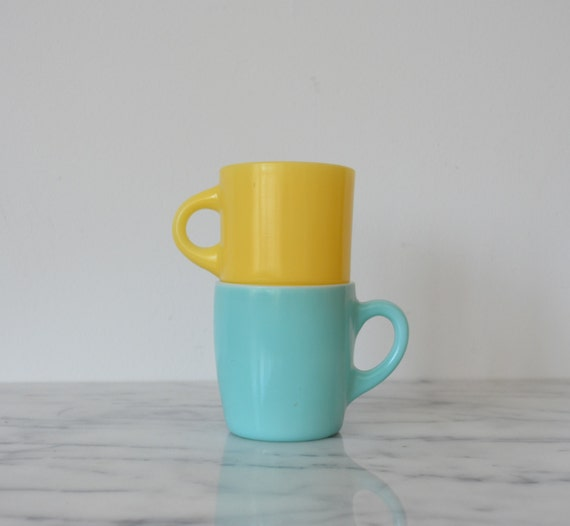 mismatched pair yellow and turquoise glass mugs  fireking yellow mug