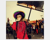 Flambeaux Bearer: square fine art portrait photograph print of fire - flame torch at Mardi Gras Endymion parade in New Orleans