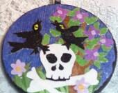 Ravens resting on skull, wood tile necklace