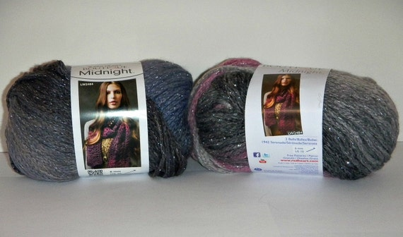 2 Different Balls of Red Heart Boutique Midnight yarn