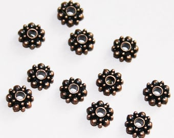 25 pcs of Antique Copper  flower spacer beads 6x3mm