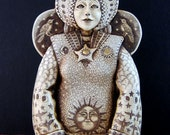 Celestial Goddess moon sun bird  and stars wall plaque scrimshaw resin