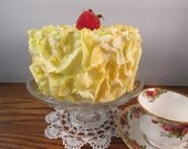 Lemon Yellow Cake Faux Flower Petal Cake with a Strawberry on Top
