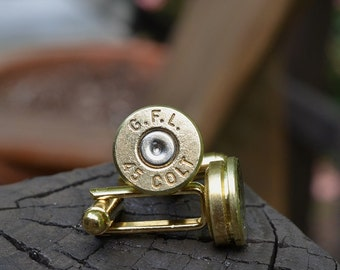 Bullet cufflinks fashioned from repurposed gold/brass Fiocchi .45 Long Colt shell casings
