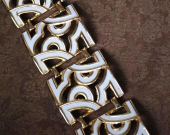 Modernist  vintage 80s gold tone metal and white enamel  large panels  wide bracelet with cutouts design.