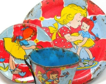 Tin Toy Tea Setting,Cup & Saucer with Little Red Headed Girl, tin litho.