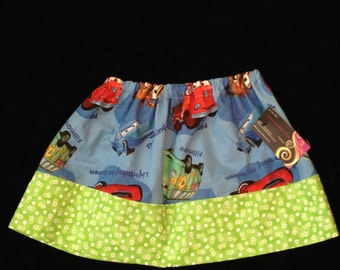Girls Cars inspired skirt size 2-3T  with flower trim. Hand made and ready to ship. Personal monogramming available
