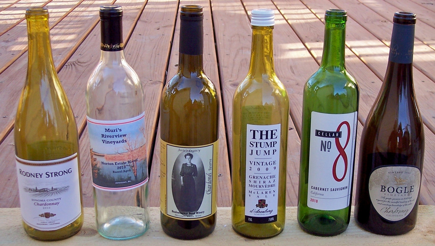 6 empty used wine bottles with labels variety of colors for What to make with empty wine bottles