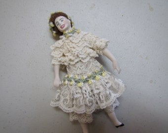 Porcelain dollhouse doll 1/12 scale in lace and flowers