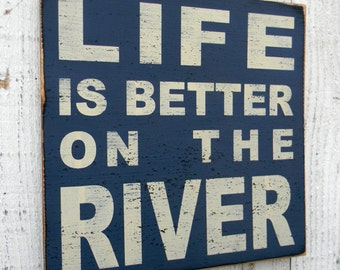 Life is better on the River typography distressed wood sign