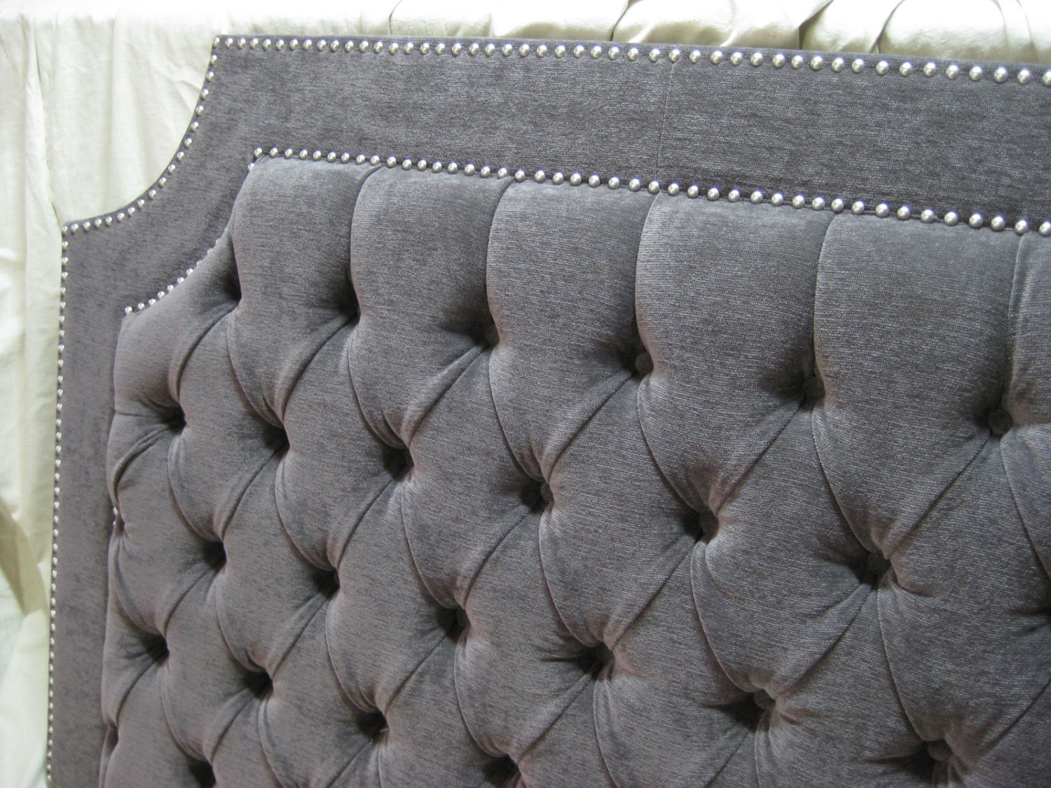 gray tufted upholstered headboard with nickel nailheads. Black Bedroom Furniture Sets. Home Design Ideas