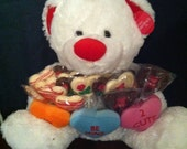 Plush Teddy Bear with a Arm Full of Assorted Chocolate lollipops