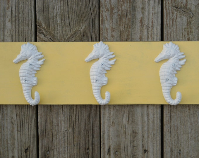 3 seahorse towel hooks key rack foyer mudroom organization cottage renovation beach home coastal living Outer Banks Beach House Dreams