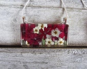 Valentines Ruby Red verbena.  1x2 inch clear glass.