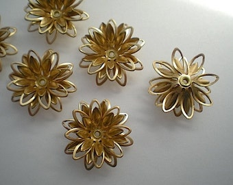 6 brass 3-D flower stampings