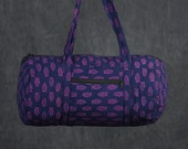 Quilted Duffle bag in Navy Blue with Fuchsia pink floral Print.