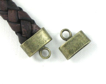 12 cord jewelry END CAPS in Antique Bronze . Large and Oval . 9mm x 3.5mm Hole (EC3ab)