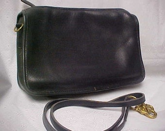 Black leather Coach purse/cross body/shoulder bag size 11 X  1/2 X 3 inches-USA