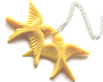 Mustard yellow flying kissing resin lovebird pendant silver necklace