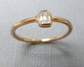 Emerald cut diamond ring.   Modern emerald cut diamond engagement ring. 14k pink gold emerald cut diamond ring.