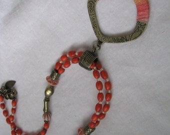 Dramatic orange beaded necklace with gold tone accents & wrapped pendant by Coldwater Creek