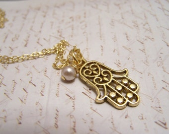Hamsa Necklace. Hand of Fatima. Protection. brass with ivory glass pearl