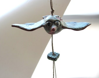 Valentines day gifts--Ceramic miniature BirD on string.--------BLUE--- FLY--Gift under 50 USD