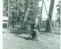 1969 Little Boy Posing In Front of Swing Set Backyard Swings Vintage Black And White Photo Photograph
