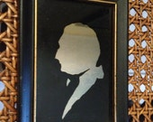 Reverse glass silhouette portrait