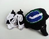 Vancouver Canucks helmet and ice skates, nhl skates, Vancouver Canucks