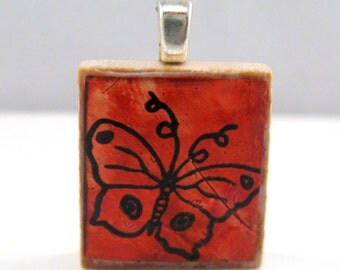 Red whimsical butterfly - Glowing metallic Scrabble tile pendant