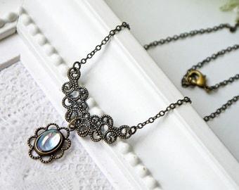 Blue Glass Necklace Light Sapphire Aurora Borealis  Antique Brass Vintage Style Necklace