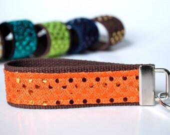 Key fob sparkle sequin fabric wristlet in orange color