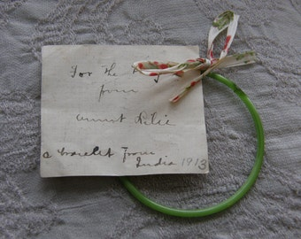 Antique green glass baby bangle bracelet from India with personal gift tag dated 1913